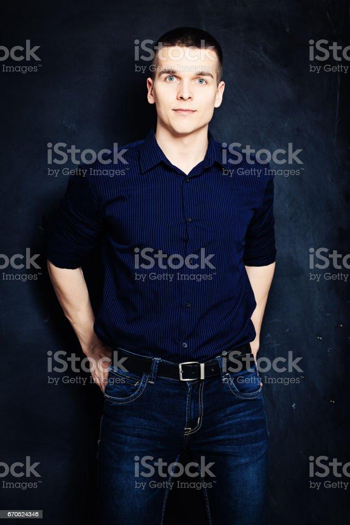 dbdb785eddd6c Young Man Portrait Guy On Dark Blue Background Stockfoto und mehr ...
