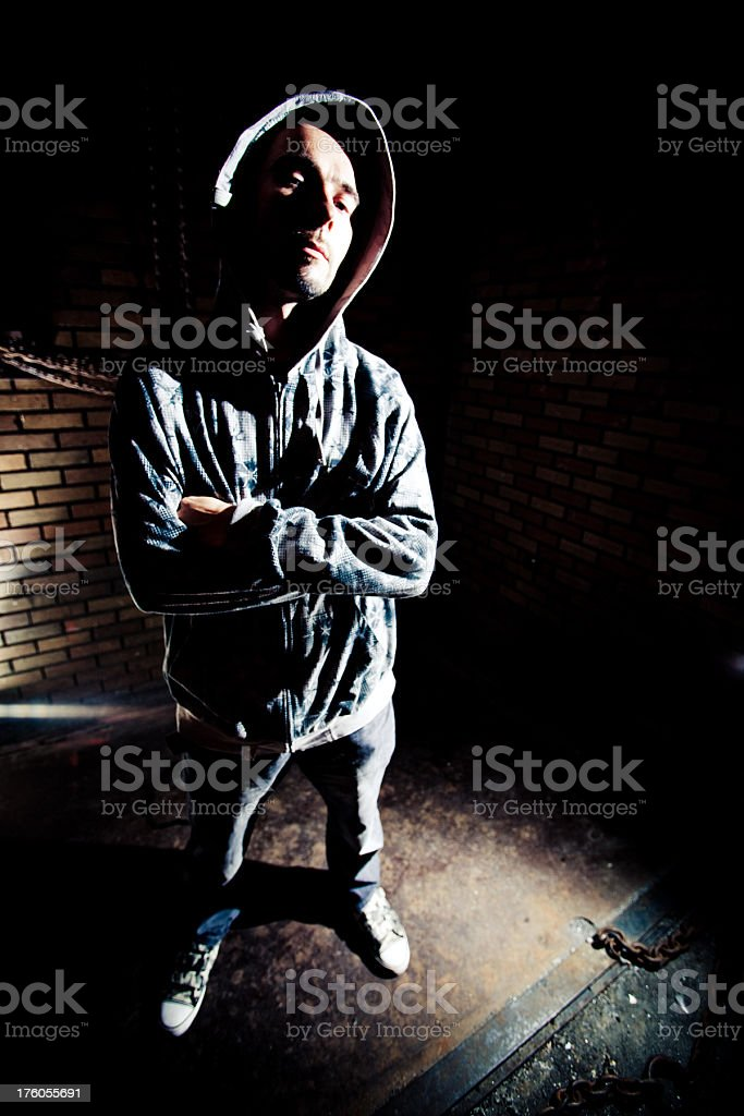 Young man portrait in dark alley royalty-free stock photo