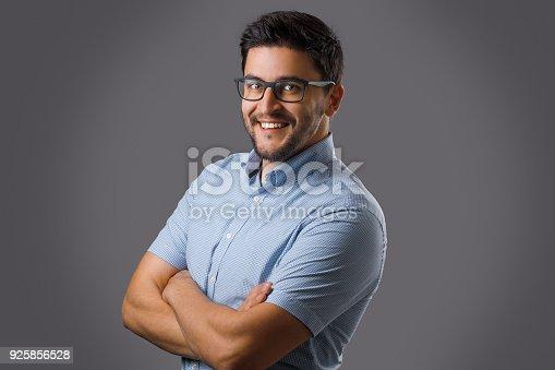 612752180istockphoto Young man portrait on grey 925856528