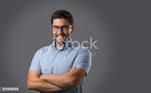 612752180istockphoto Young man portrait on grey 925856558