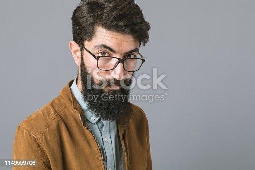 Studio portrait of elegant man with eyewear.