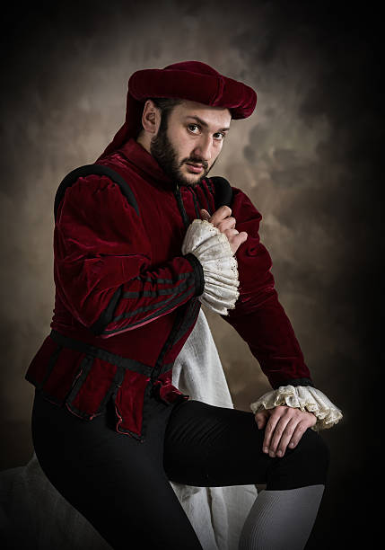 young man posing in theatrical costume - renaissance style stock photos and pictures