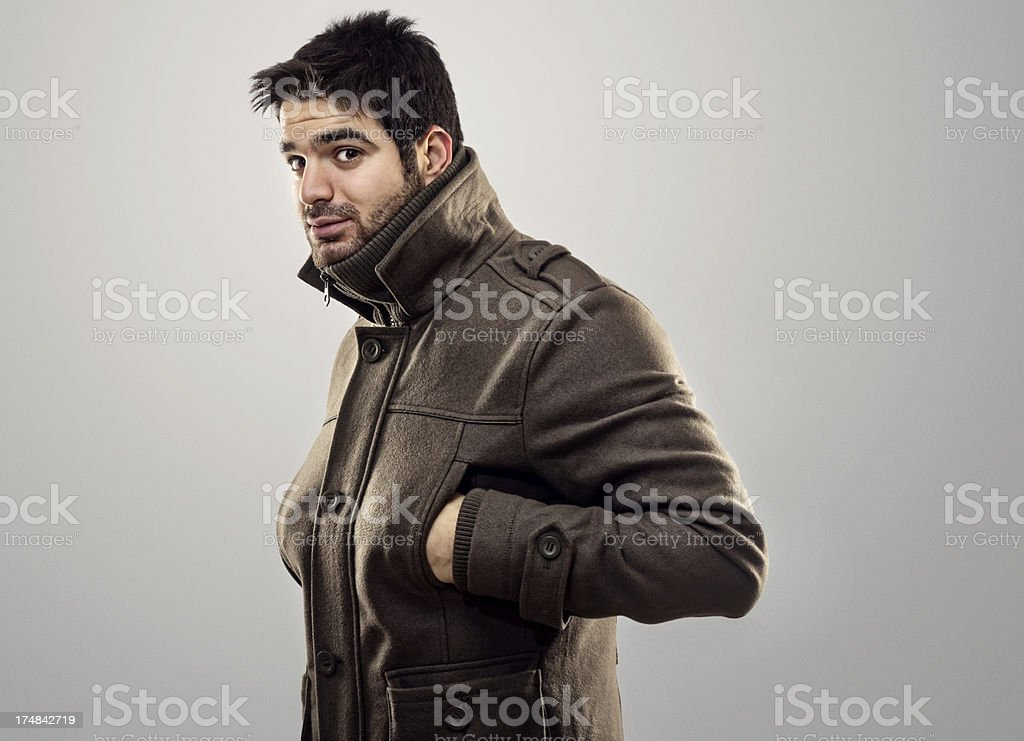 Young man posing in winter coats royalty-free stock photo