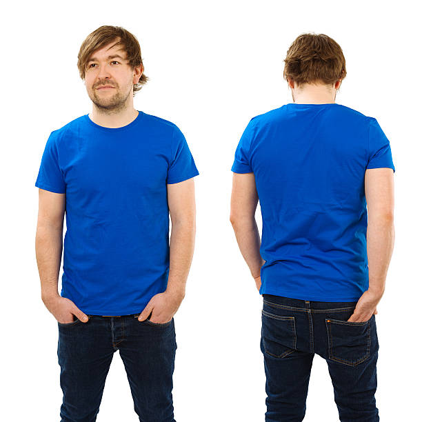 Young man posing with blank blue shirt stock photo