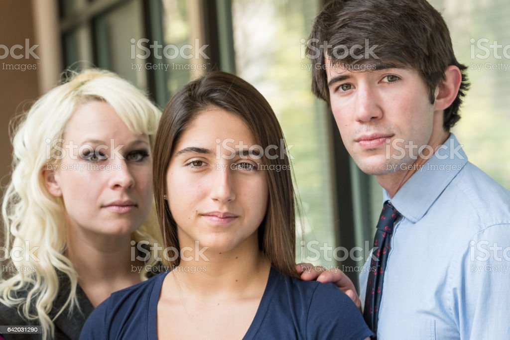 Young man posing with two young women stock photo