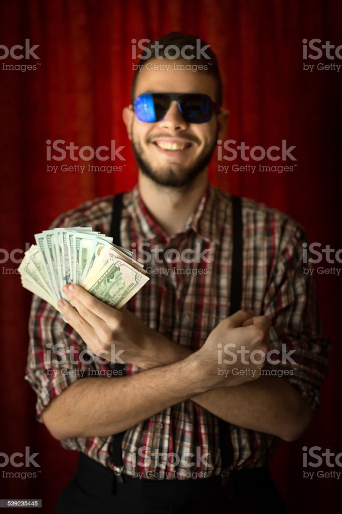 young man posing with usa dollars royalty-free stock photo