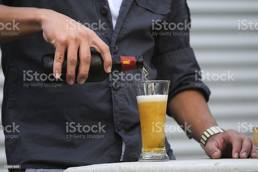 Young Man Pouring Beer royalty-free stock photo