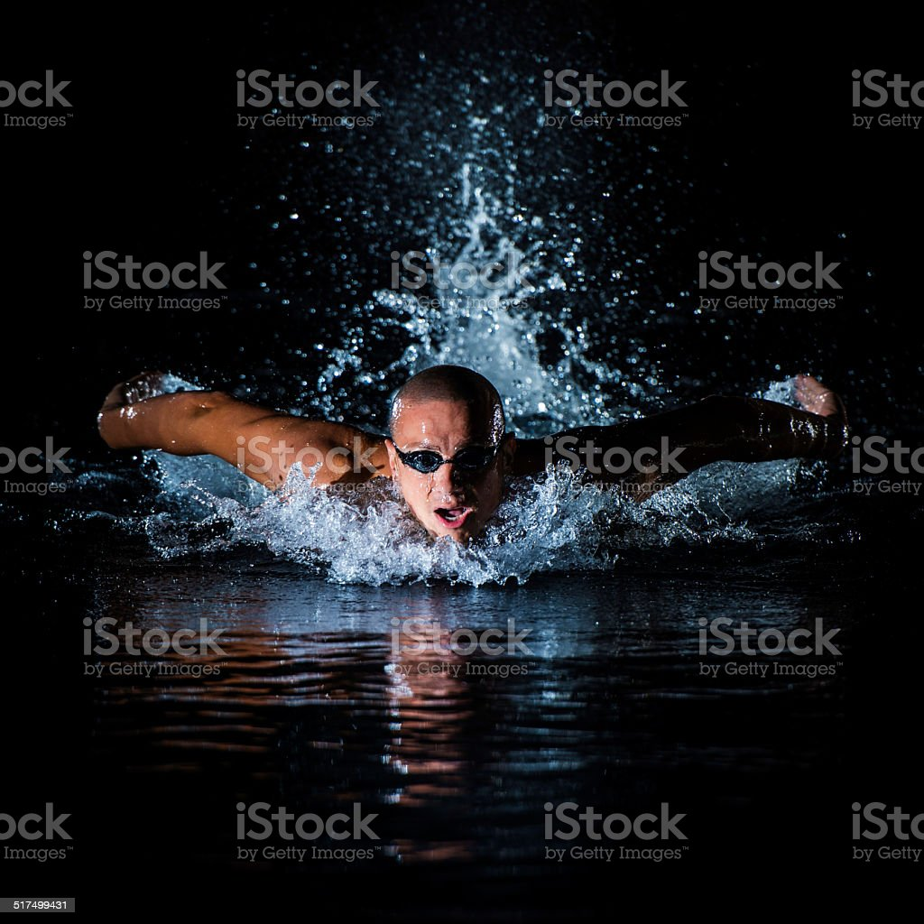 Young Man Practicing Butterfly Stroke stock photo