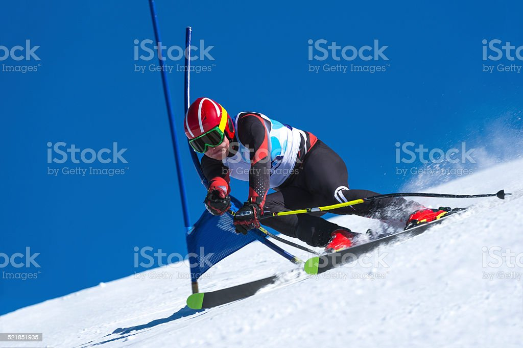 young Man Practicing Giant Slalom stock photo