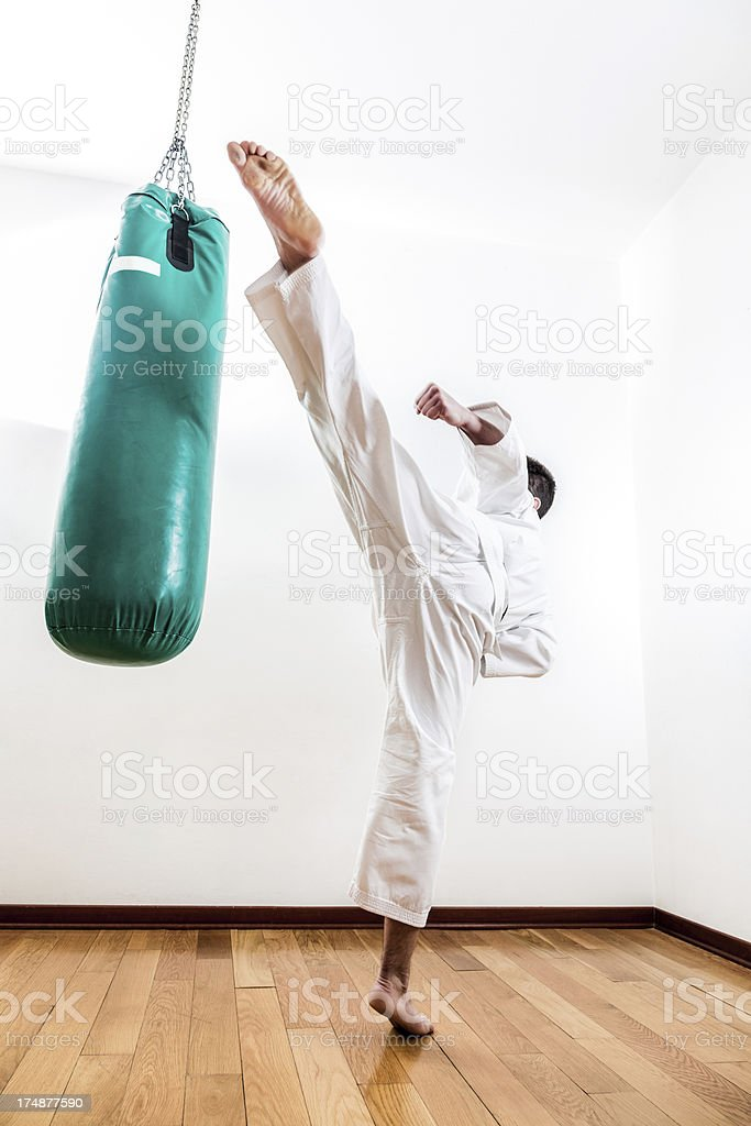 Young man practicing martial arts royalty-free stock photo