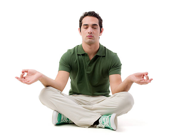 young man practicing yoga - sitting on floor stock photos and pictures