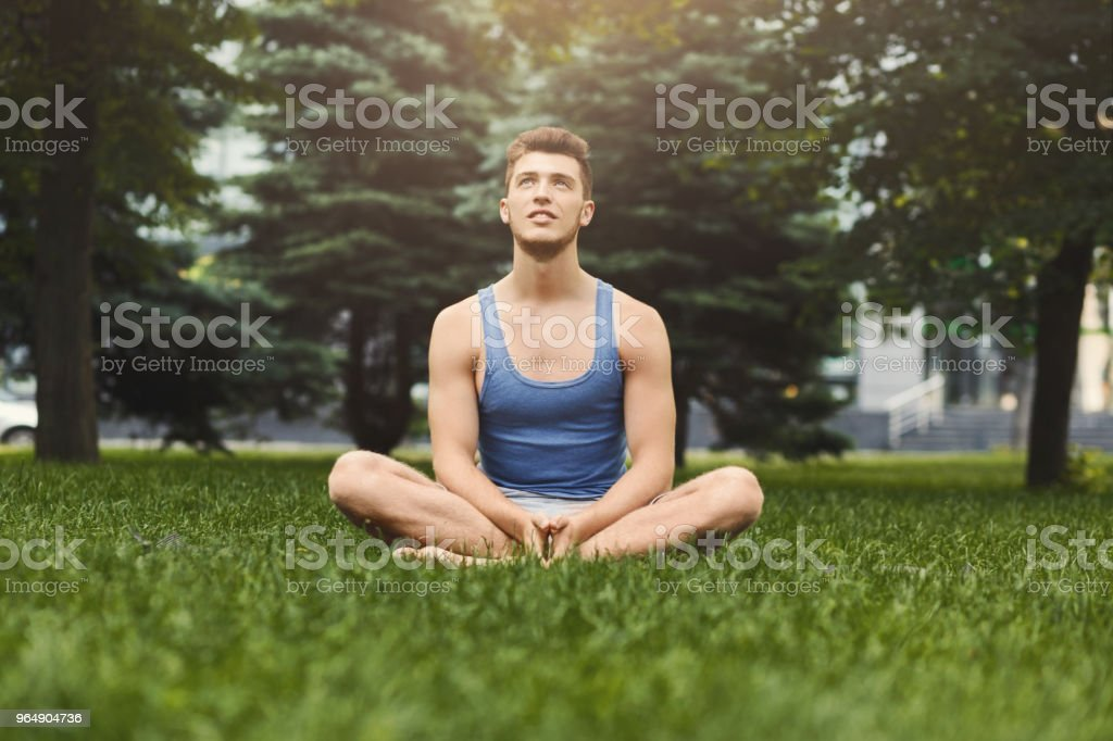 Young man practicing yoga, relax meditation pose royalty-free stock photo