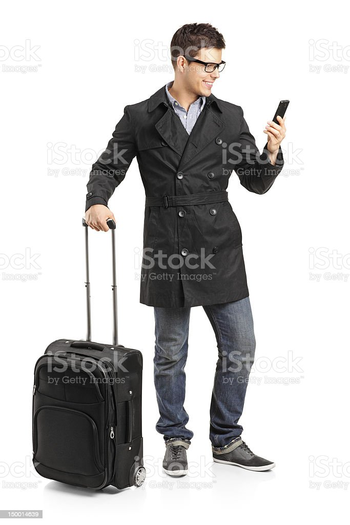 Young man prepared for a yourney typing sms royalty-free stock photo