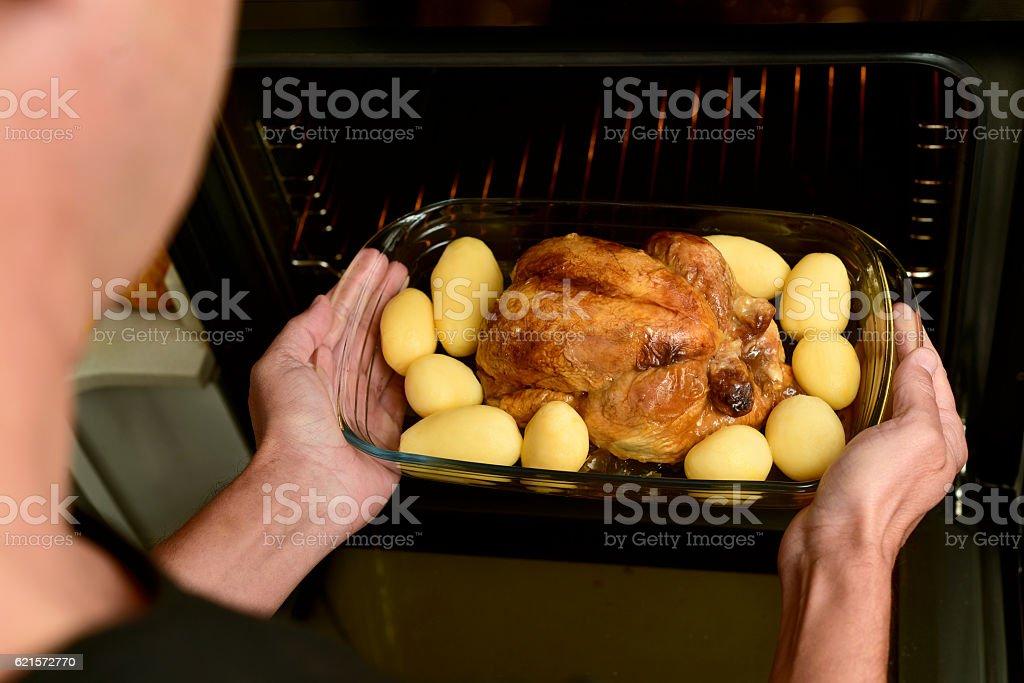 young man preparing a roast turkey photo libre de droits