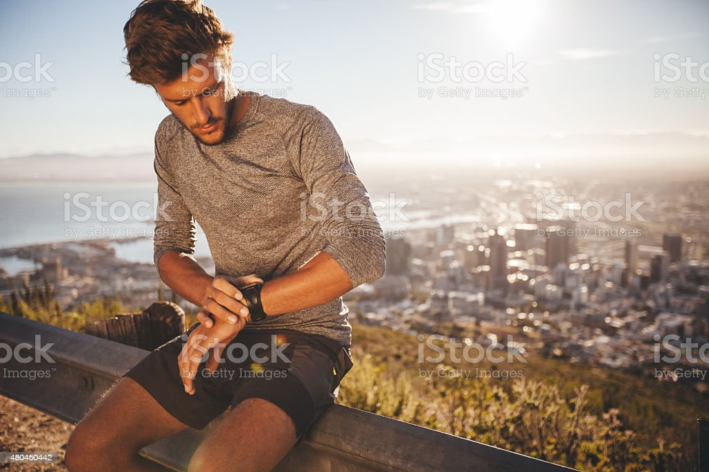 Young man preparing for a run stock photo