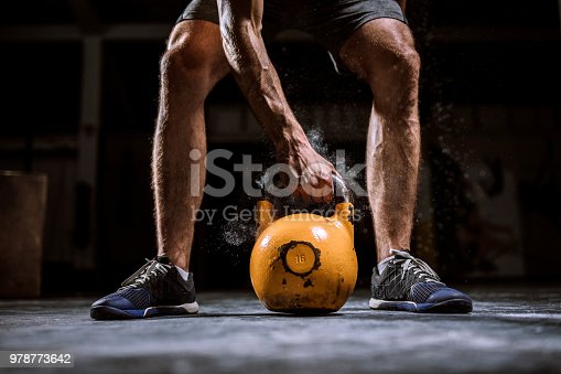 944655208 istock photo Young Man Preparing For lifting Barbell 978773642