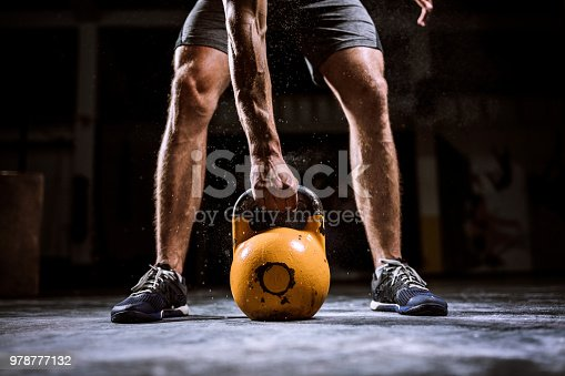 944655208 istock photo Young Man Preparing For lifting Barbell 978777132