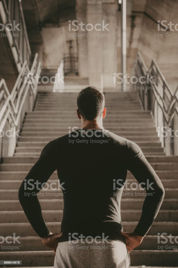 Young man preparing to workout stock photo