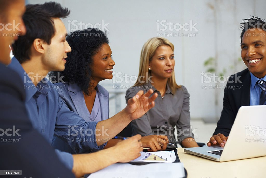 Young man presenting his ideas to business team royalty-free stock photo
