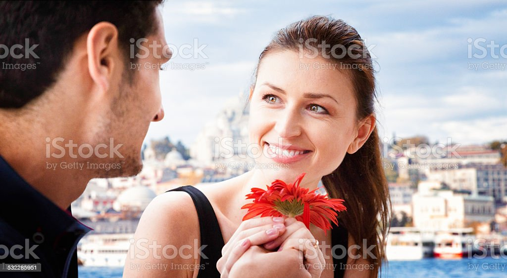 Young man proposes to his grilfriend on Istanbul cruise stock photo