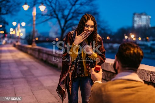 Young Caucasian man proposing to his beautiful girlfriend.