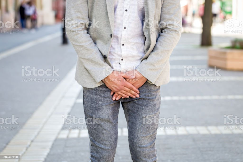 young man prostate problem stock photo