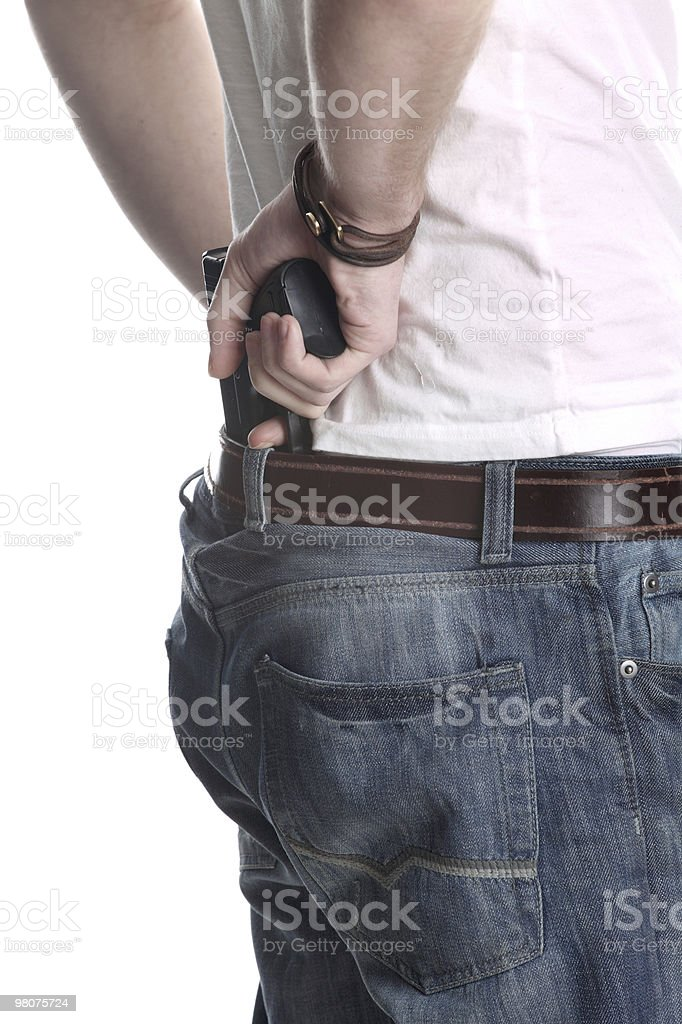 Young man pulling his gun royalty-free stock photo