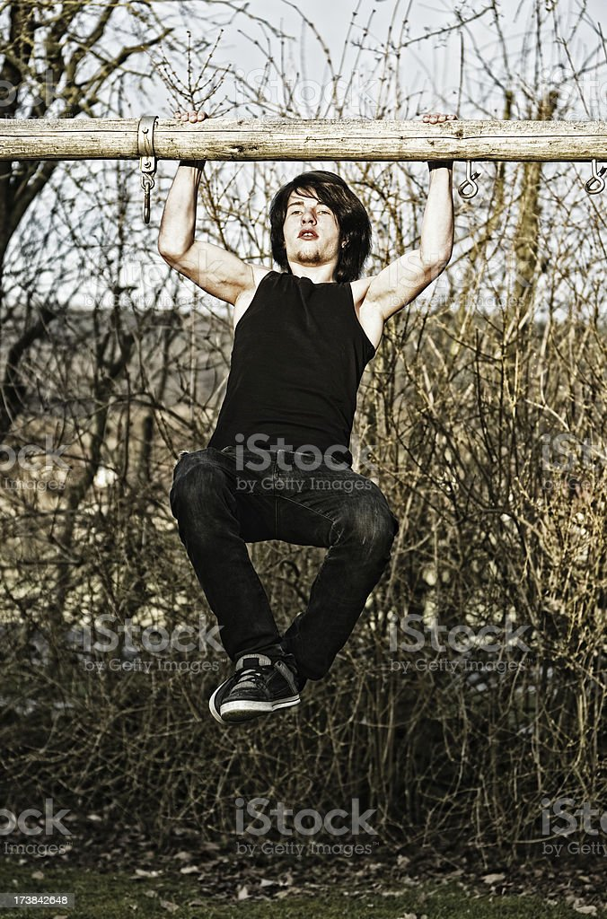 Young Man Pulling Up royalty-free stock photo
