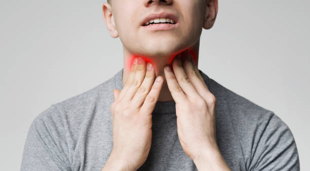 Young man pulping his inflamed neck, close up Breathing problem. Young man pulping his inflamed neck, close up throat stock pictures, royalty-free photos & images