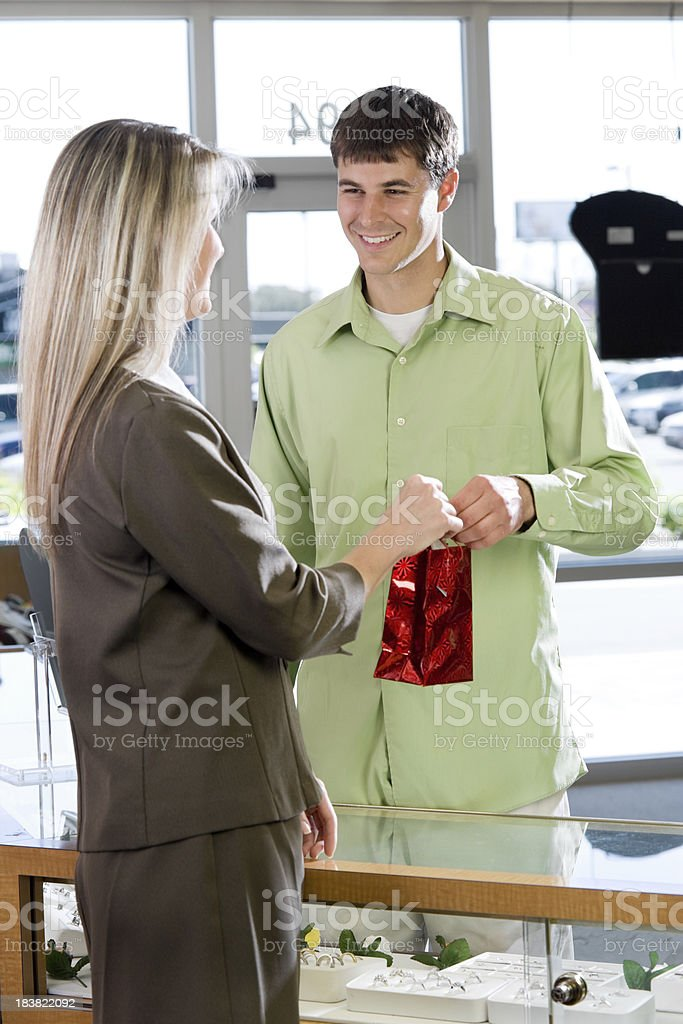 Young man purchasing Jewelry royalty-free stock photo