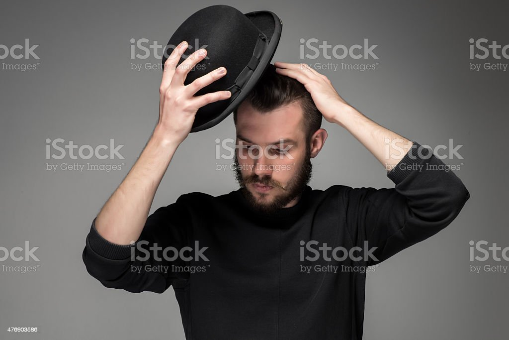 Young man raising his hat  in respect and admiration for stock photo