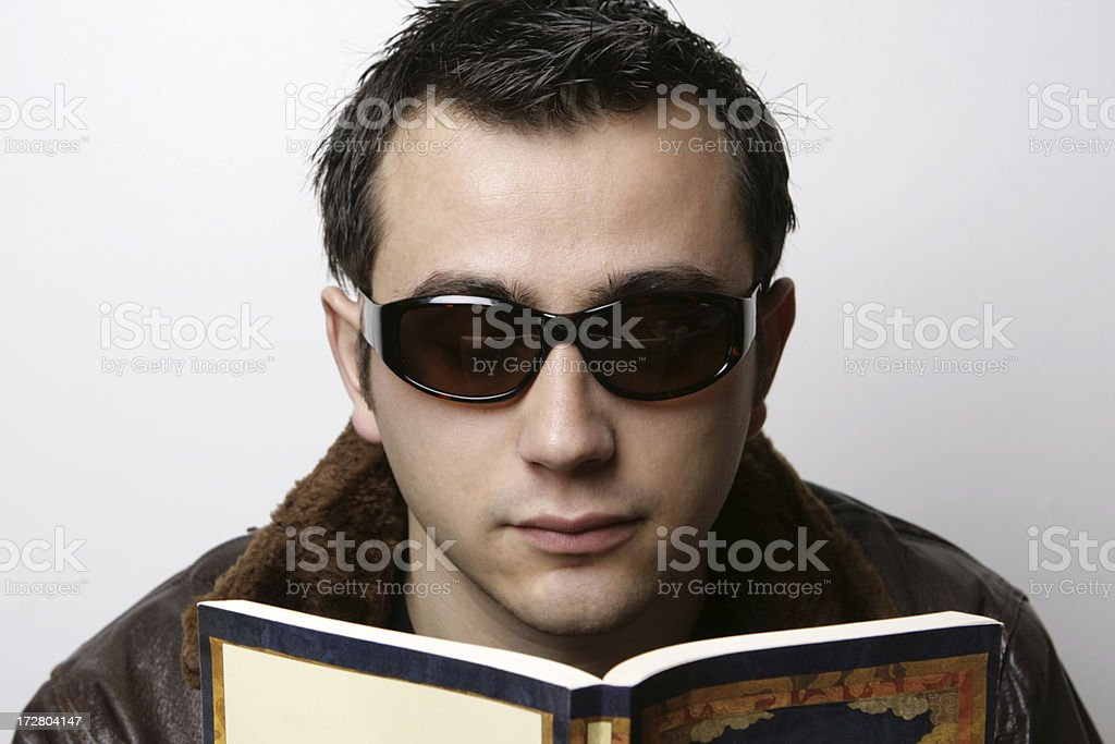 Young Man Reading a Book royalty-free stock photo