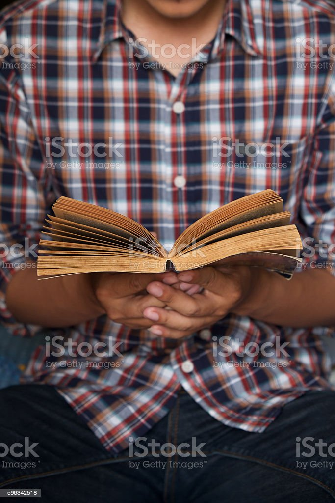 Young man reading a book,Vintage effect. royalty-free stock photo