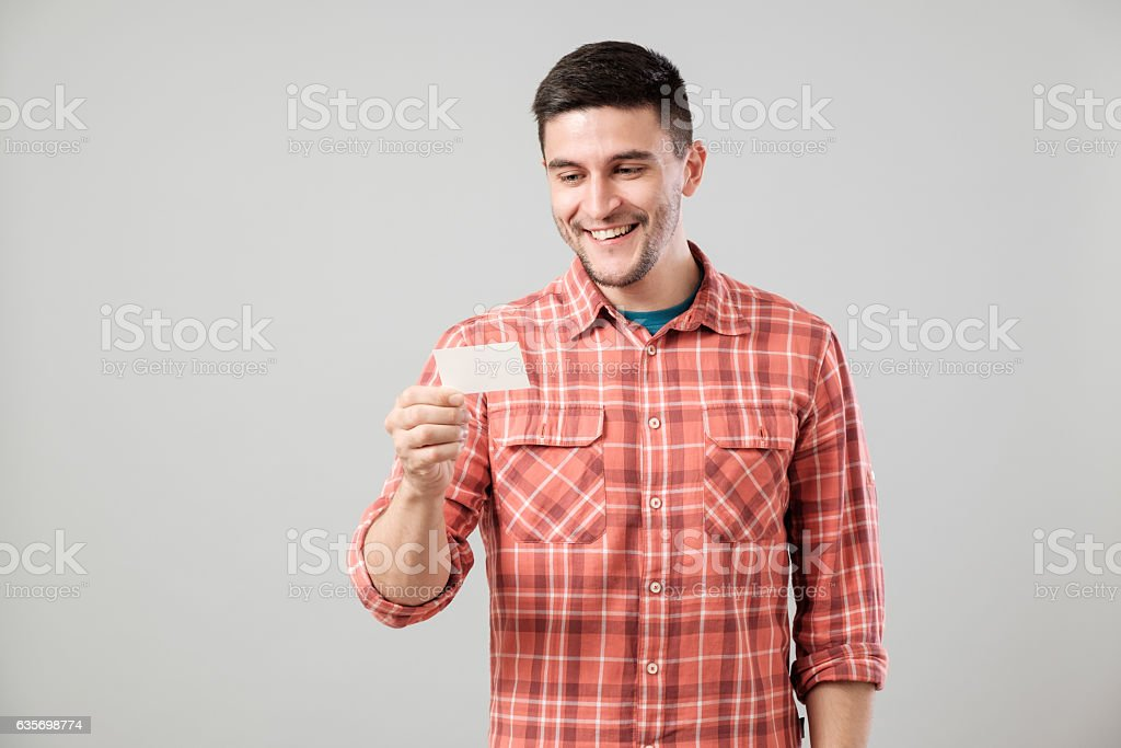 Young man reading business card royalty-free stock photo