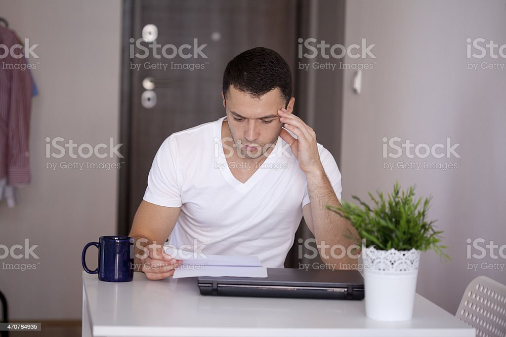 young man reading document royalty-free stock photo