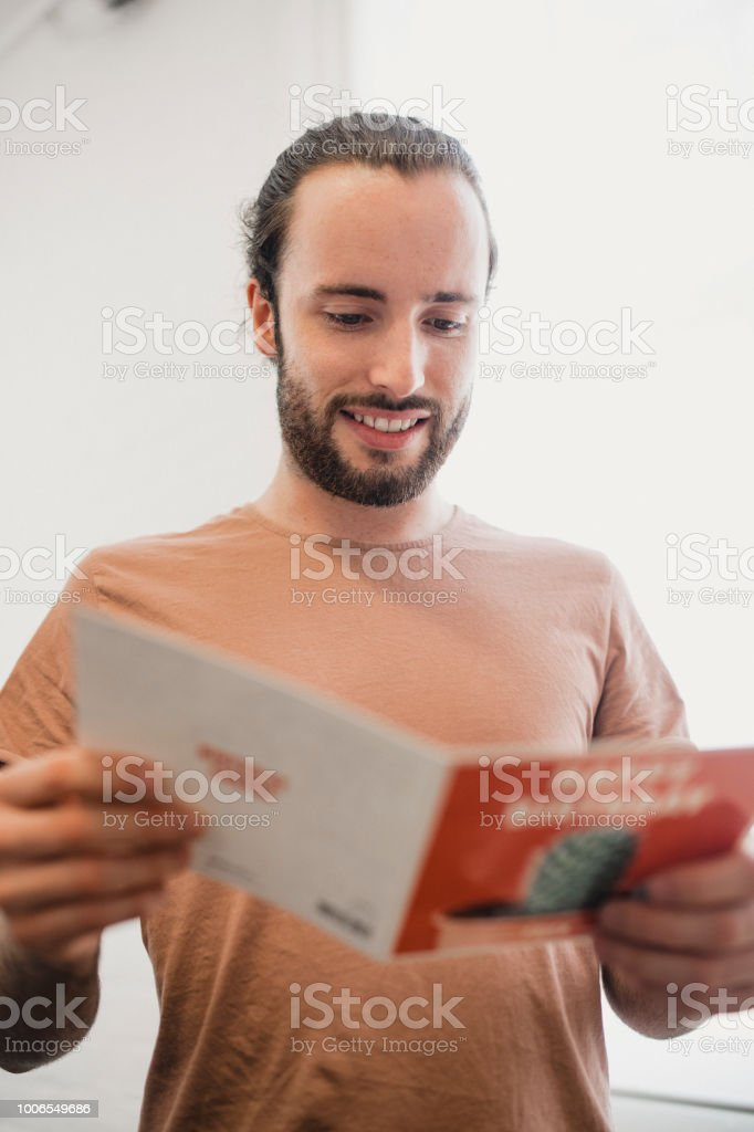 Young Man Reading His Birthday Card