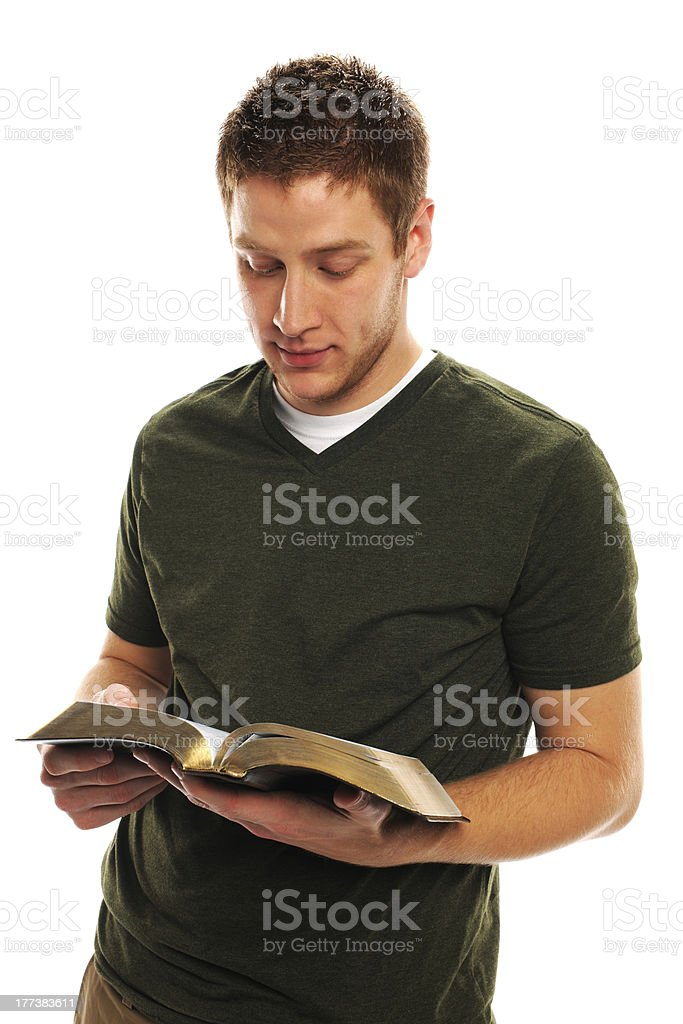 Young Man Reading The Bible stock photo