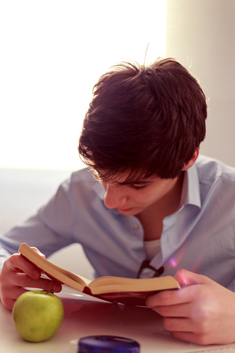 Young man reads a book