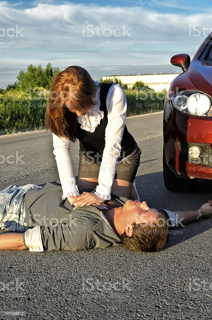 Young man reanimation on a road. Concept first aid stock photo