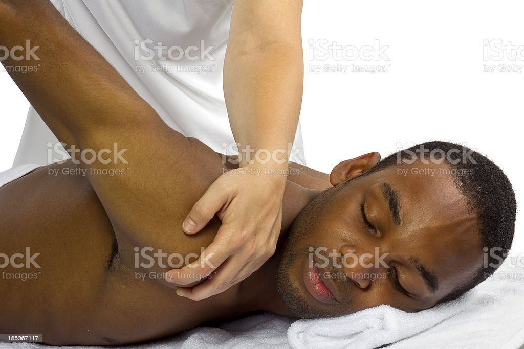 Young man receiving a back massage stock photo