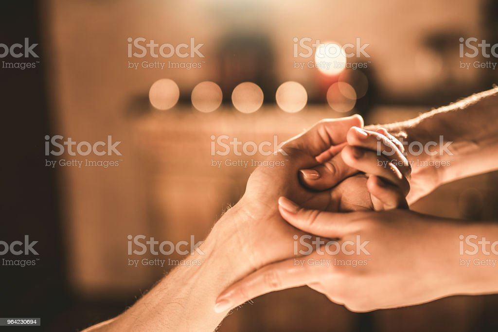 Young man receiving a hand massage close-up. stock photo