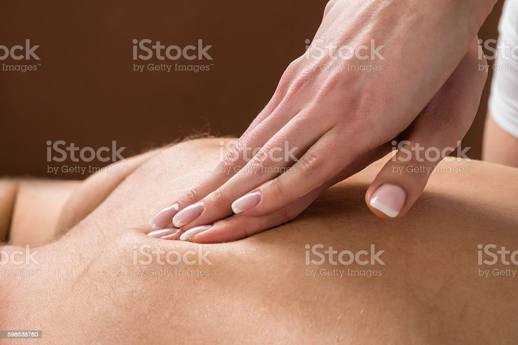 Young Man Receiving Back Massage photo libre de droits