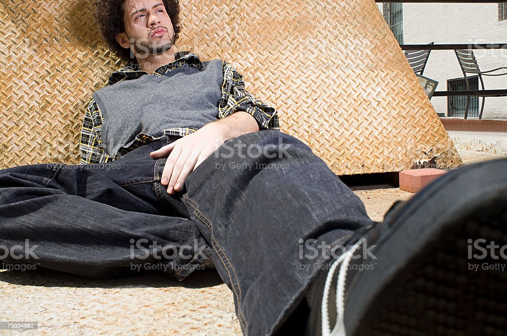 Young man reclining royalty-free stock photo