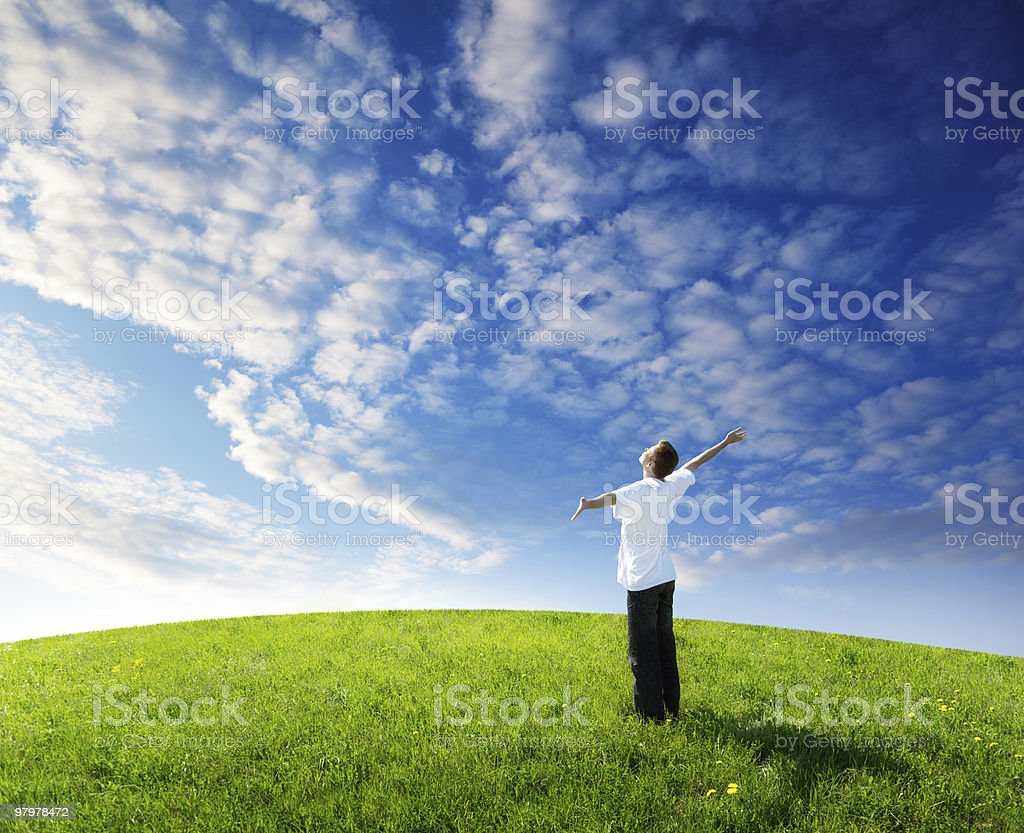 young man relax on the green field royalty-free stock photo