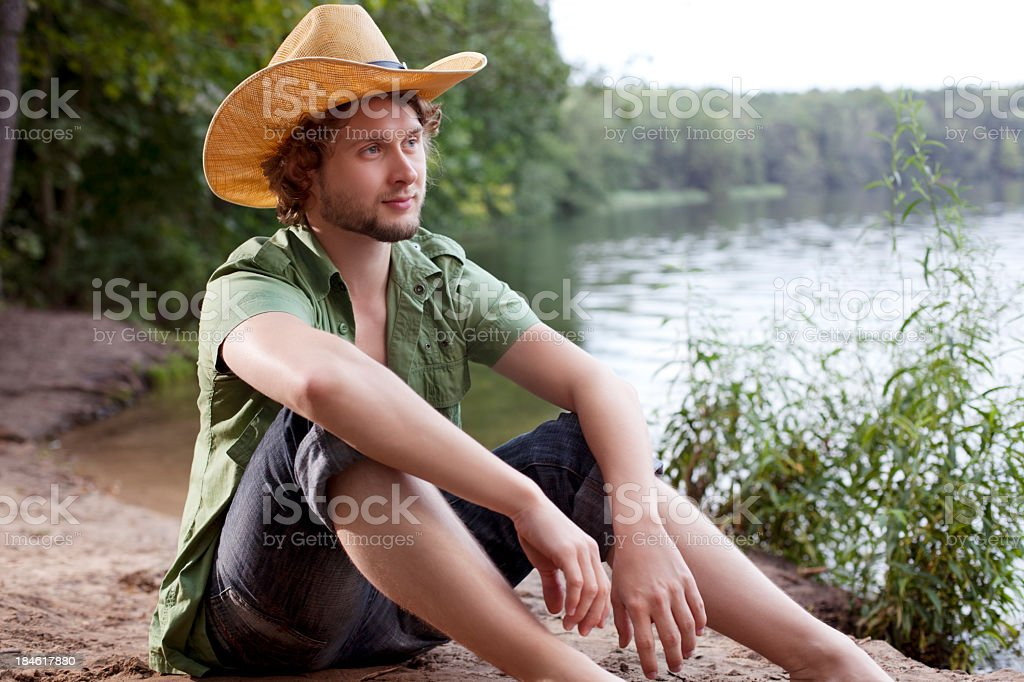 Young man relaxing at the lake royalty-free stock photo