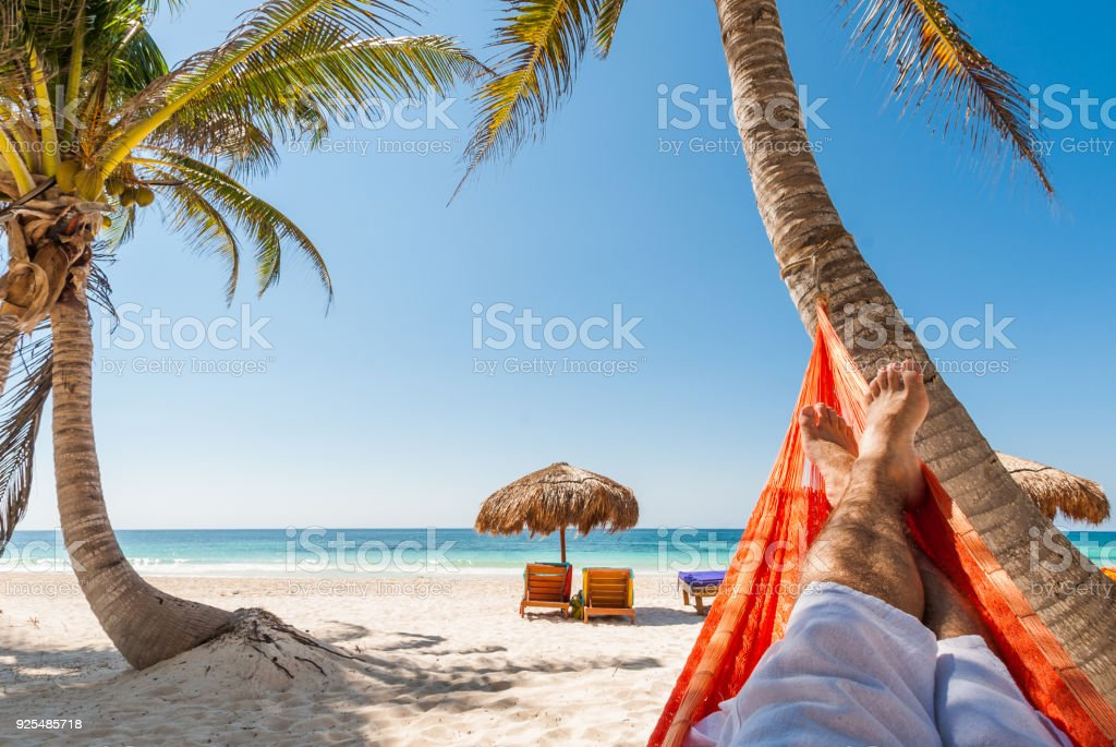 Young man relaxing on a tropical beach stock photo