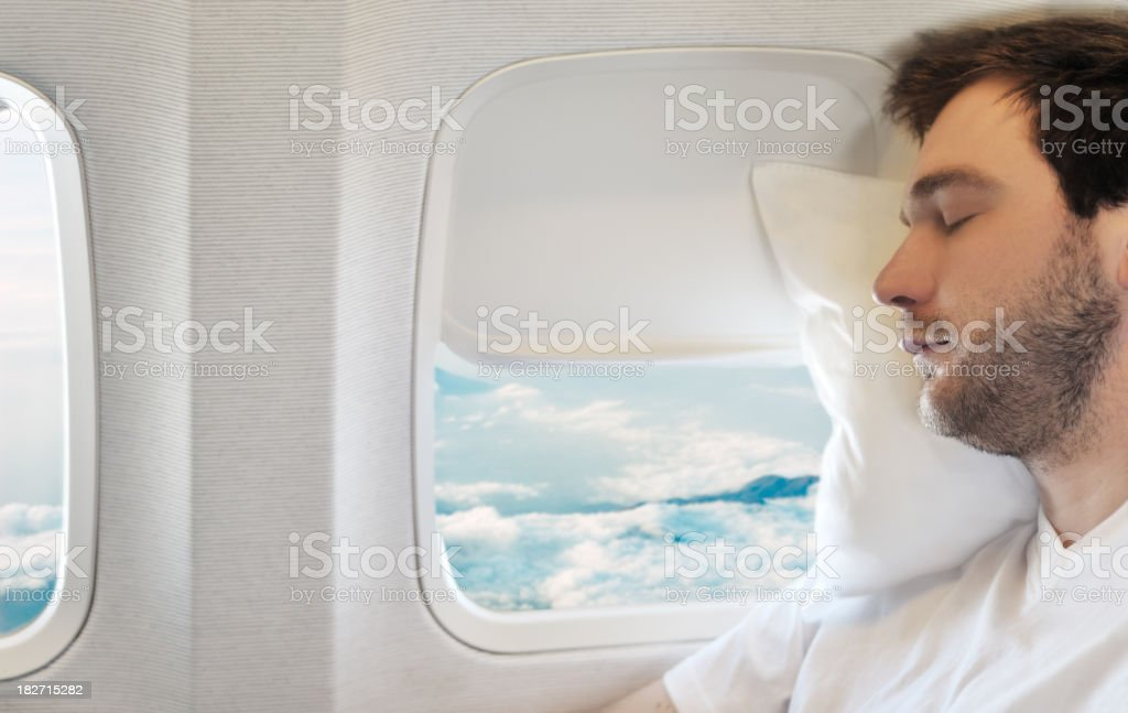 Young man relaxing on aircraft royalty-free stock photo