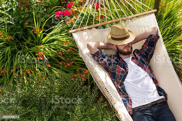 Young Man Relaxing On Hammock Stock Photo - Download Image Now
