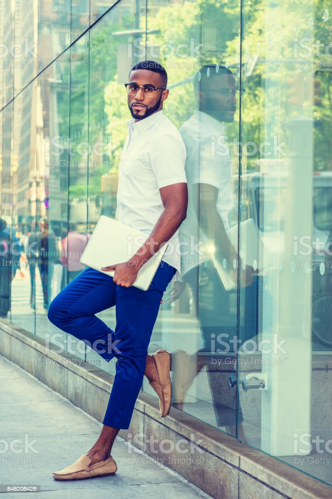 Young Man relaxing on street in New York stock photo