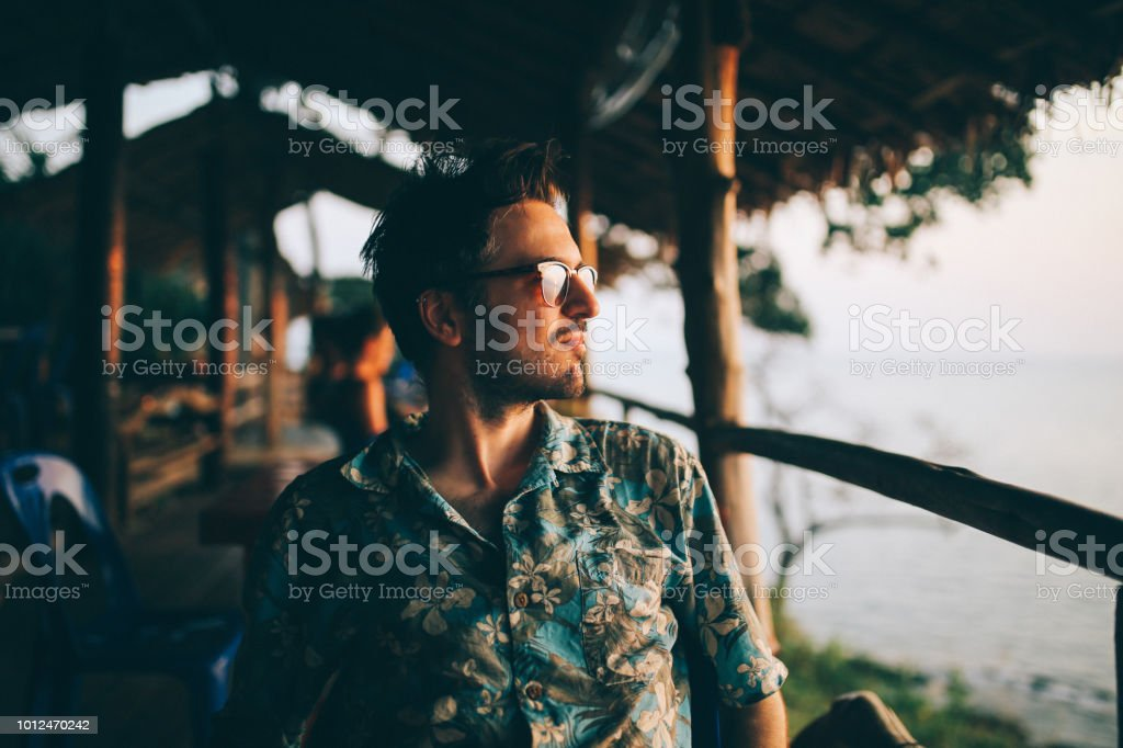 Young man relaxing on the beach of the Koh Lanta island, Thailand stock photo